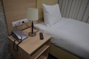 Кровать или кровати в номере Silver House Hotel