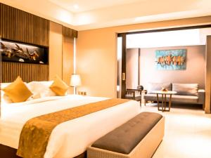 A bed or beds in a room at The Nest Hotel by Danapati