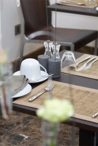 A restaurant or other place to eat at The Rooms Lytham