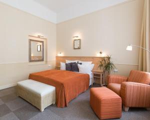 유니타스 호텔 객실 침대