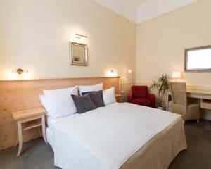 Кровать или кровати в номере Unitas Hotel