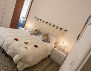 A bed or beds in a room at Camere Fontanavecchia