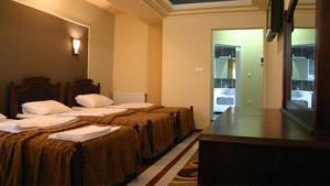 A bed or beds in a room at Hotel Dinamika