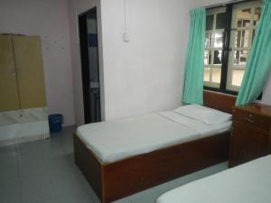 Cama o camas de una habitación en Twin Pines Guest House