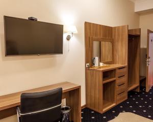 Телевизор и/или развлекательный центр в Central City Hotel Makhachkala