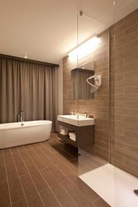 Łazienka w obiekcie Hotel City Maribor