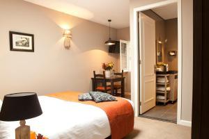 Een bed of bedden in een kamer bij Hotel-Herberg D'n Dries