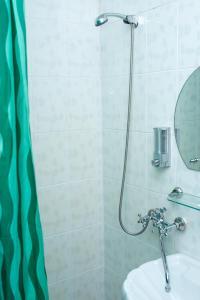 Ванная комната в Hotel Urypinsk