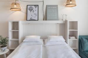 Ein Bett oder Betten in einem Zimmer der Unterkunft Falkensteiner Hotel Park Punat
