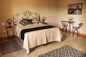A bed or beds in a room at Pousada Estância das Montanhas