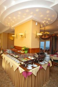 Hotel Polaris IIIにあるレストランまたは飲食店