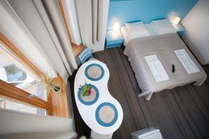 A bed or beds in a room at Moja Accommodation