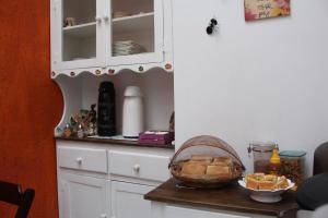 A cozinha ou cozinha compacta de Villa Hostel