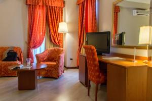 A television and/or entertainment center at Excel Hotel Roma Ciampino
