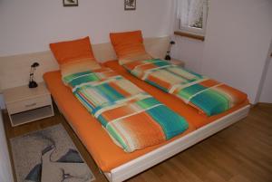 Ein Bett oder Betten in einem Zimmer der Unterkunft Appartementhaus La Promenade