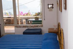 Letto o letti in una camera di Bouganville & Sea