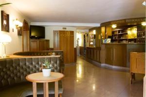 The lobby or reception area at Hotel Molnár