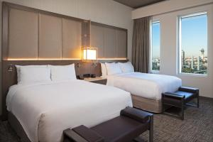A bed or beds in a room at H Hotel Los Angeles, Curio Collection By Hilton