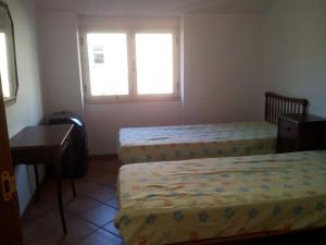 A bed or beds in a room at casa al mare