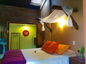 A bed or beds in a room at La Buena Vida Hotel