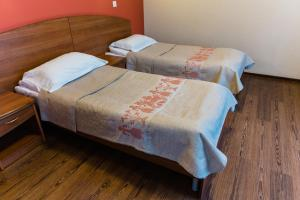 Кровать или кровати в номере Отель Онежский замок