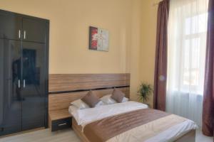 Lova arba lovos apgyvendinimo įstaigoje Best Season Apart Hotel