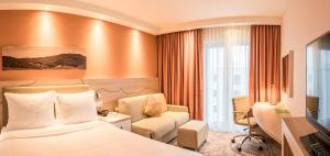 A bed or beds in a room at Hampton By Hilton Freiburg