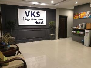 The lobby or reception area at VKS Hotel