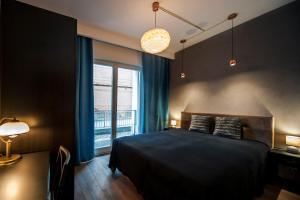 Łóżko lub łóżka w pokoju w obiekcie Very Berry - Orzeszkowej 10 - MTP Apartment, parking, balcony, check in 24h