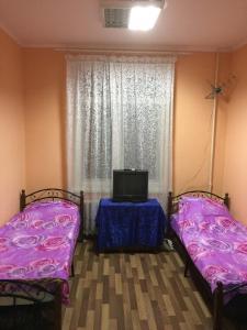 Кровать или кровати в номере Gostinitsa Alfa Hostel