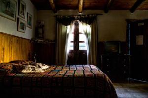 Una cama o camas en una habitación de Cabañas de Montaña Rio Amarillo