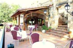 Un restaurante o sitio para comer en Hotel Infantado