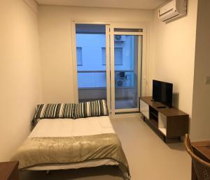 Cama ou camas em um quarto em Apto Praia Ingleses 3q 2g