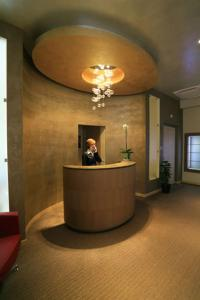 The lobby or reception area at Turin Airport Hotel & Residence
