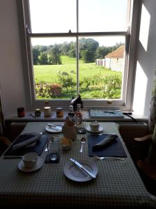 A restaurant or other place to eat at Kilsham Farm