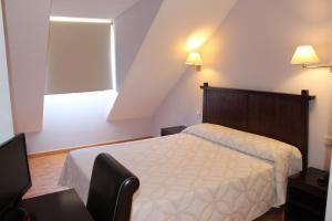 Cama o camas de una habitación en Apartahotel Villa de Parla