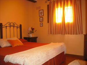 A bed or beds in a room at Casa de Oria