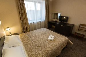 Кровать или кровати в номере Гостиница Лесная