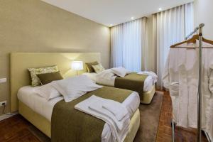 Een bed of bedden in een kamer bij Casas do Porto