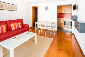 Zona de estar de Pateo Santo Estevao-Self Catering Apartments