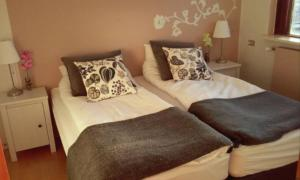 A bed or beds in a room at BSG Apartments