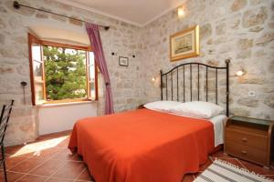 A bed or beds in a room at Apartments and rooms by the sea Cavtat, Dubrovnik - 8974