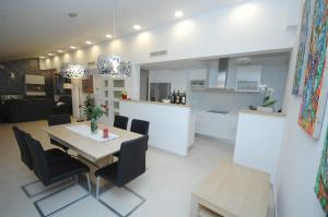A kitchen or kitchenette at Family friendly house with a swimming pool Mlini, Dubrovnik - 12828