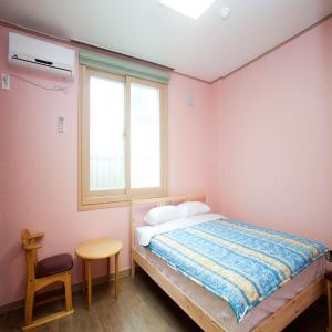 A bed or beds in a room at You&I Guesthouse