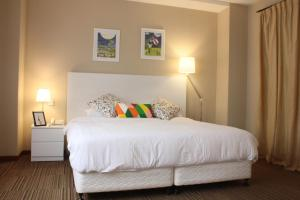 A bed or beds in a room at Alocassia Serviced Apartments (SG Clean)