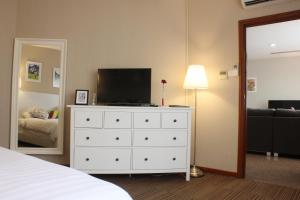 A television and/or entertainment center at Alocassia Serviced Apartments (SG Clean)