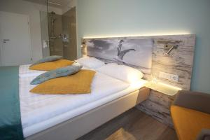 A bed or beds in a room at City Hotel