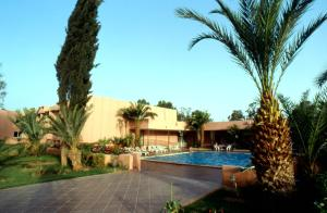 The swimming pool at or near Le Zat