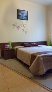 Łóżko lub łóżka w pokoju w obiekcie Przystań Wodna Brody