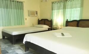 A bed or beds in a room at The Boracay Beach Resort